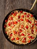 pic of cooked crab  - close up of rustic spicy italian crab and cherry tomato spaghetti pasta - JPG