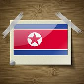 picture of north star  - Flags of Korea North at frame on wooden texture - JPG