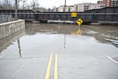 stock photo of underpass  - A flooded 9 underpass on a cloudy day in the Chicago area - JPG