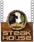 pic of food chain  - Wooden sign with text Steak House round symbol with head of cow forks and empty ribbon - JPG