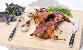 stock photo of quail  - Roasted Quail with rosemary and spices on the wood background - JPG