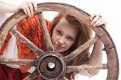 image of wagon wheel  - young woman with an old wagon wheel on white background - JPG