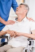 picture of male nurses  - Kind male nurse and his senior patient in wheelchair at hospital - JPG