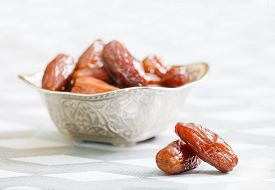 picture of bismillah  - Beautiful bowl full of date fruits symbolizing Ramadan - JPG