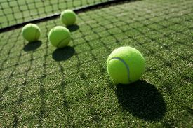 stock photo of grass  - tennis balls on outdoor tennis grass court - JPG