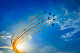 foto of fighter plane  - Aerobatic team performs flight at an air show - JPG