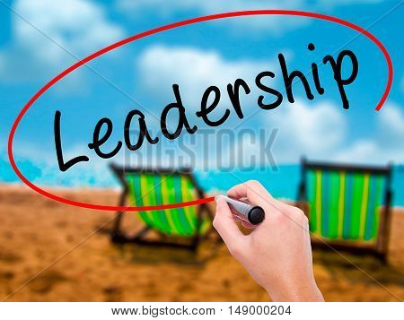 Man Hand Writing Leadership With Black Marker On Visual Screen
