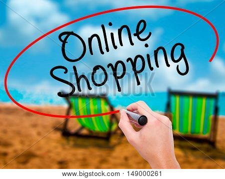 Man Hand Writing Online Shopping With Black Marker On Visual Screen