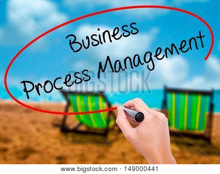 Man Hand Writing Business Process Management With Black Marker On Visual Screen