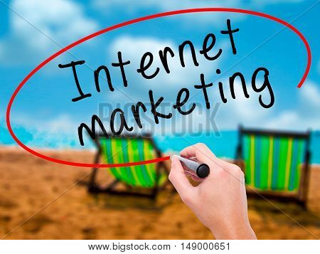 Man Hand Writing Internet Marketing With Black Marker On Visual Screen