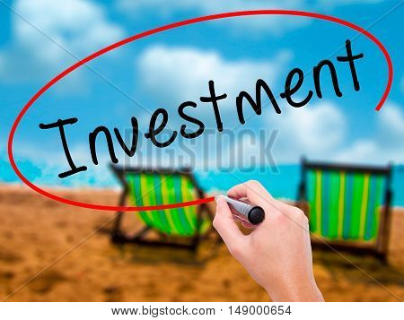 Man Hand Writing Investment With Black Marker On Visual Screen