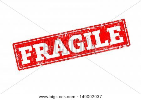 FRAGILE written on red rubber stamp with grunge edges