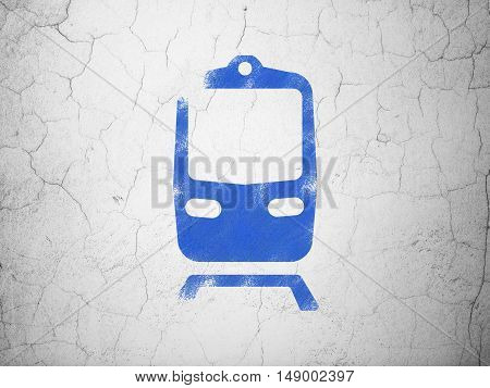 Vacation concept: Blue Train on textured concrete wall background