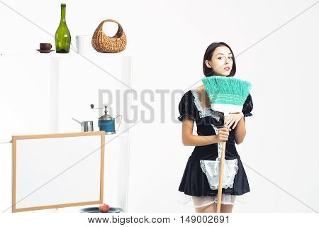 Young Girl Maid With Broom