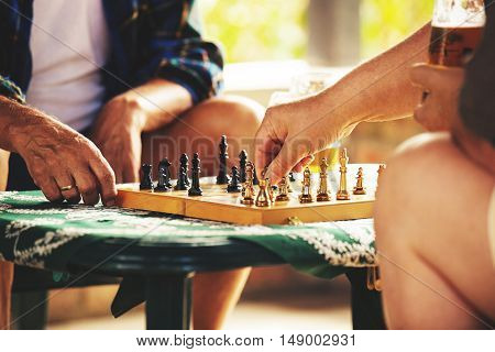 Two senior friends playing chess early in the morning.