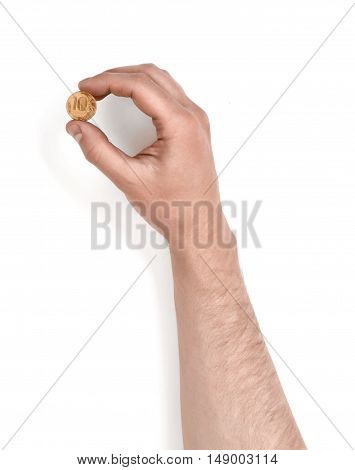 Close up view of a man's hand holding a coin isolated on white background. Money input. Copy space for vending machine.
