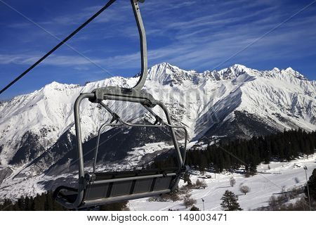Chair-lift At Ski Resort And Snow Winter Mountains In Nice Sun Day