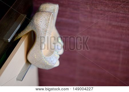 Beautiful colorful wedding shoes for bride indoors. Beauty of bridal heel for marriage. Female couple boots for celebration