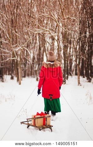 Girl Enjoying A Day Out Playing In The Winter Forest. Girl Walki