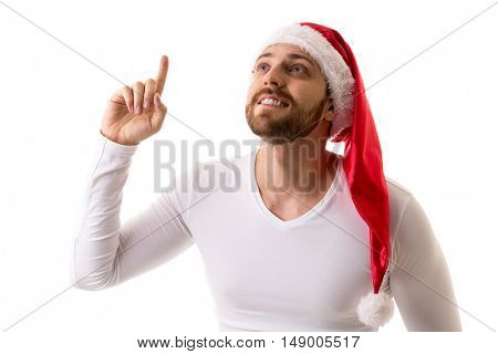 Bearded man in red santa claus christmas hat