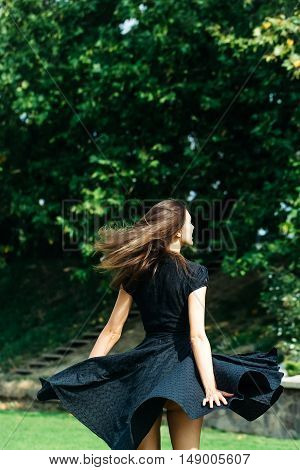 Attractive Young Girl With Spinning Dress
