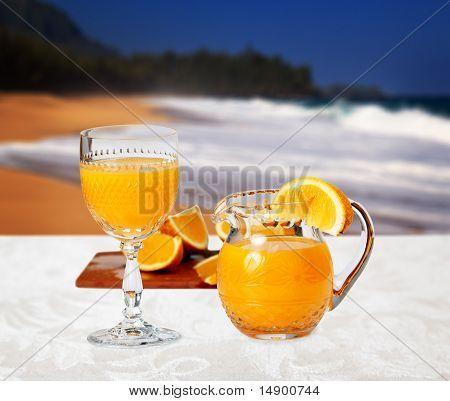Glass Of Orange On The Beach
