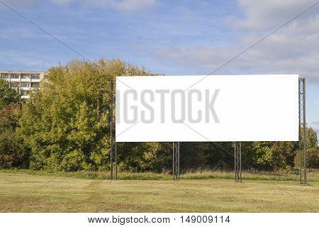 Mock up. Outdoor advertising, blank billboard outdoors, public information board on city road