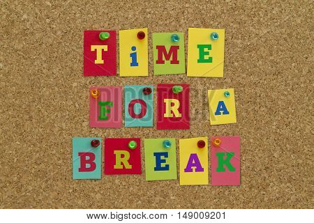 TIME FOR A BREAK message written on colorful sticky notes pinned on cork board.