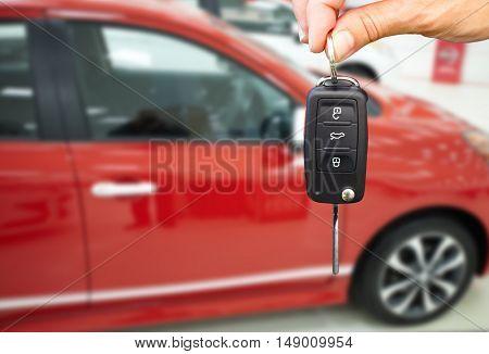 Dealer hand with a car key.