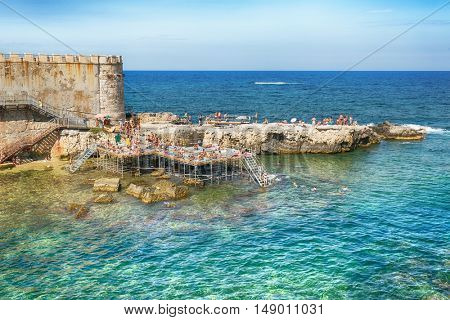Syracuse, Sicily, Italy in July 26 2016. People Bathers on Ortigia Island, Syracuse, Sicily. Italy.