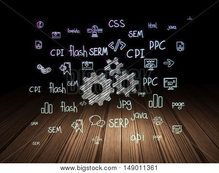 Web development concept: Glowing Gears icon in grunge dark room with Wooden Floor, black background with  Hand Drawn Site Development Icons