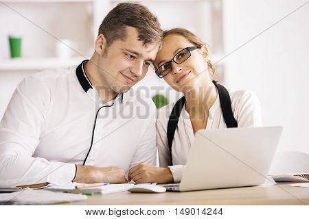 Caucasian Couple In Office