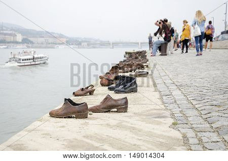 BUDAPEST, HUNGARY - SEPTEMBER 17: Shoes on the Danube Promenade - a monument to victims of the Holocaust, on September 17, 2016 in Budapest, Hungary.