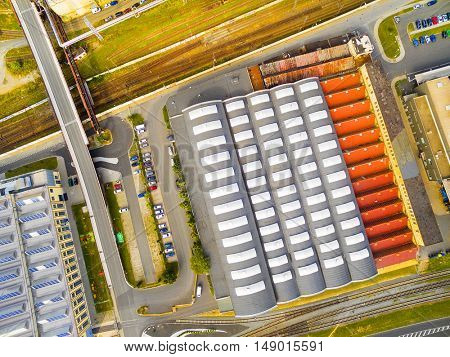 Aerial view to industrial zone and technology park. European industry from above. Architectural background.