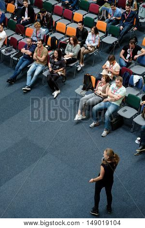 Moscow, Russia - September 3, 2016: People attend Digital Marketing Conference in big hall at day time. Top view.