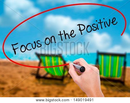 Man Hand Writing Focus On The Positive With Black Marker On Visual Screen