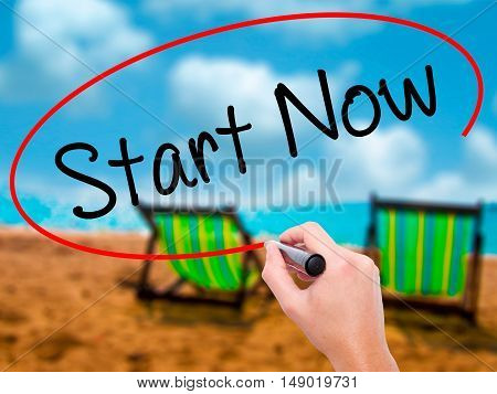 Man Hand Writing Start Now With Black Marker On Visual Screen