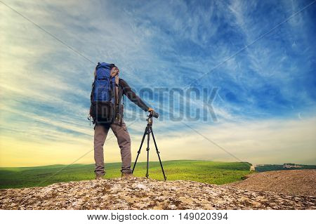Traveler in the mountains. Photographer in the mountain.