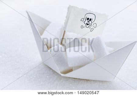 White sugar cubes in a paper boat