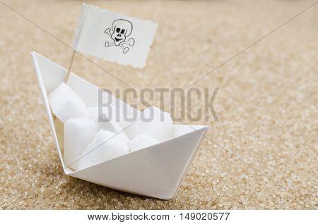 White sugar cubes on a boat in a brown sugar sea