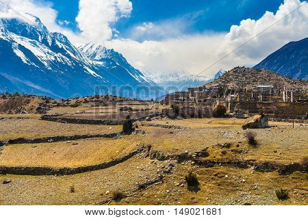Landscape Snow Mountains Nature Nepal.Mountain Trekking Landscapes Background. Nobody photo.Asia Travel Horizontal picture. Sunlights White Clouds Blue Sky. Himalayas Hills Empty Terrace