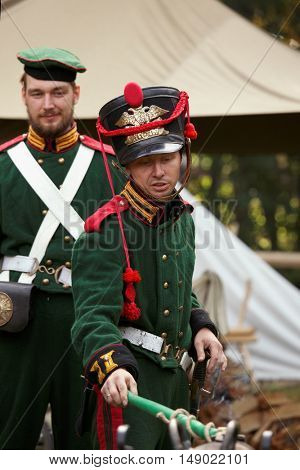 GATCHINA, ST. PETERSBURG, RUSSIA - SEPTEMBER 10, 2016: Soldiers in retro uniform of Russian army at the cannon during the festival Gatchinskaya Byl. The festival is held first time this year