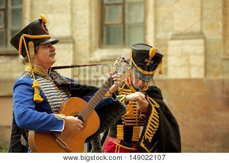 GATCHINA, ST. PETERSBURG, RUSSIA - SEPTEMBER 10, 2016: Hussars with guitar in front of Gatchina palace during the festival Gatchinskaya Byl. The festival is held first time this year