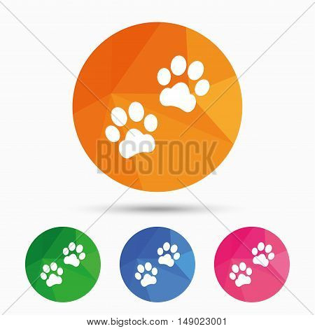 Paw sign icon. Dog pets steps symbol. Triangular low poly button with flat icon. Vector