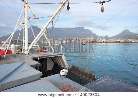 A view of Tablew mountain and the city of Cape Town from the upper deck of a fishing trawler boat as it enters the harbour from Table Bay in the Atlantic Ocean.