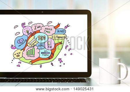 Closeup of laptop with creative colorful SEO sketch and coffee cup on white table. Search engine optimization concept. 3D Rendering