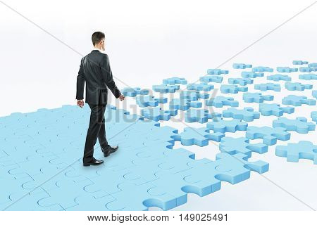 Businessman Walking On Puzzle Road