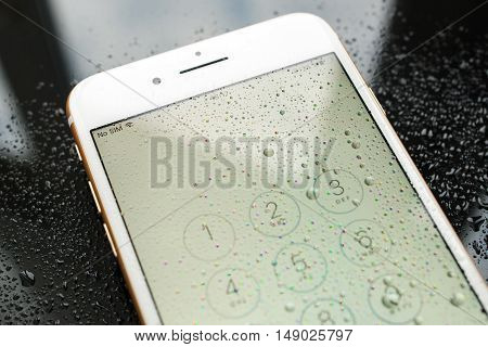 PARIS FRANCE - SEP 26 2016: New Apple iPhone 7 Plus unboxing and testing - no sim sign covered with water drops and passcode. New iPhone7 is one of the best waterproof smart phone in the world