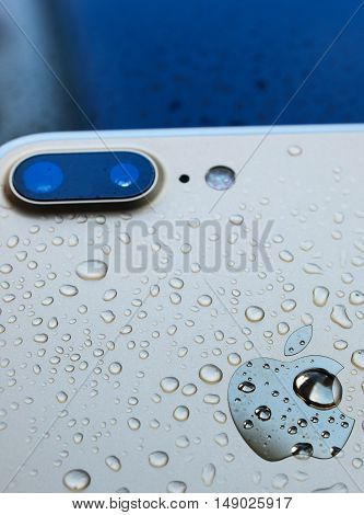 PARIS FRANCE - SEP 26 2016: New Apple iPhone 7 Plus unboxing and testing - vertical shot of rear of iphone after immersing in water. New iPhone7 is one of the best waterproof smart phone in the world
