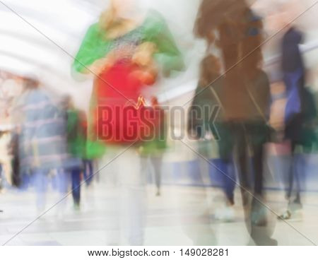 Abstract blurred subway for background . Women are in a hurry to work and for shopping